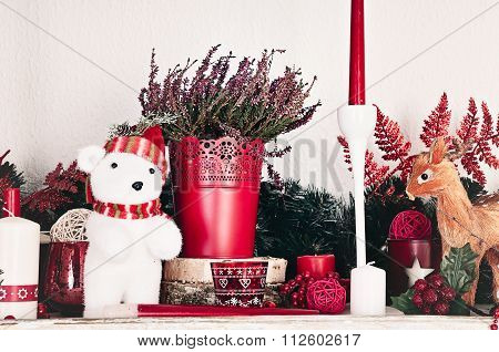 Christmas decorations with candles on a shelf