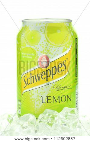 Can of Schweppes drink on ice cubes