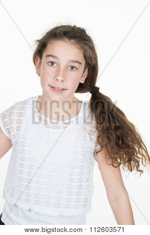 Ten Years Old Girl Smiling At Camera, On White Background.