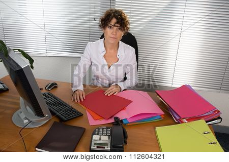Portrait Of Business Woman With Screen With A Document At Her Office