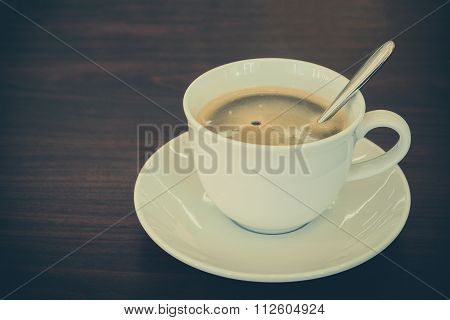 Cup Of Americano Coffee On Wooden Table