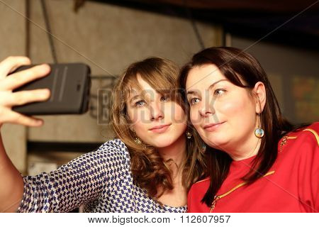 Mother With Daughter Taking Selfie