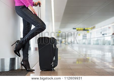 Woman waiting for flight in airport