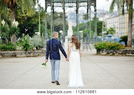 Young Couple Holding Hands In Wedding Day, Naples, Italy