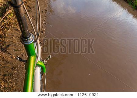 Bicycle ride through muddy dirt road