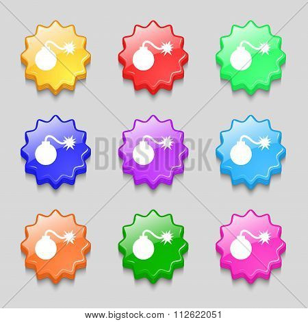 Bomb Icon Sign. Symbol On Nine Wavy Colourful Buttons.