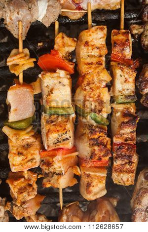 bbq meat with vegetables on stick fried on brazier