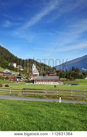 Picturesque houses in green valley. Charming Austrian province