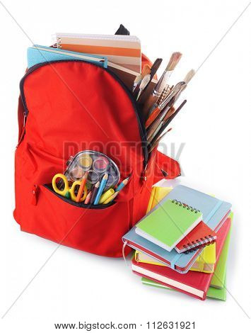 Red backpack with colourful stationary and books isolated on white background