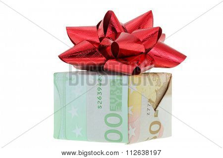 A gift box wrapped with Euro banknotes bills decorated with red gift ribbon,  isolated on white background