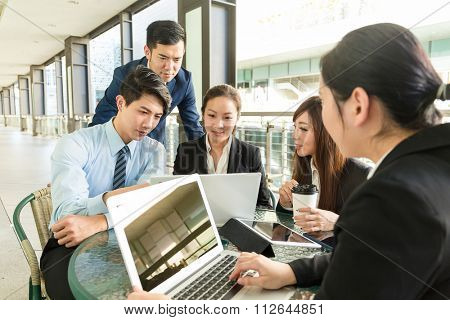 Group of business people having meeting at coffee shop