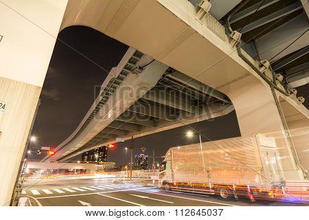 Medium truck and overpass