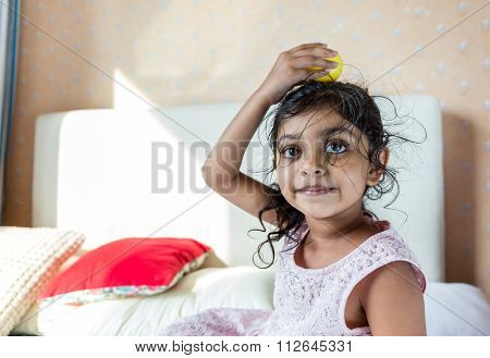 Young girl put the toy on her head