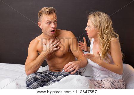 Couple having an argument in bedroom