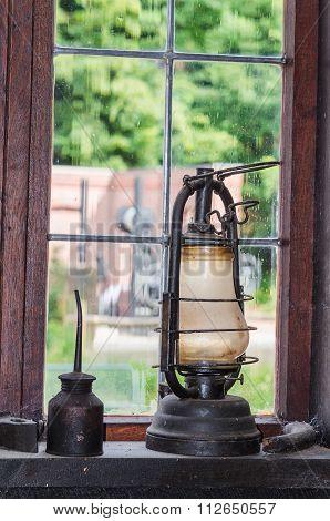 Old Kerosene Lamp On A Window Sill
