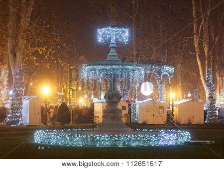 Illuminated Fountain In Zrinjevac