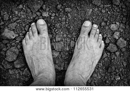 Bare foots over dry soil