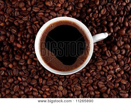 Cup of coffee isolated on roasted coffee beans