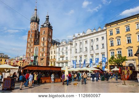 Krakow, Poland - May 15 2015: Unidentified Tourists Visiting Main Market Square In Krakow, Poland