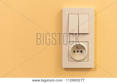 Light Switch And Socket In Frame On The Wall