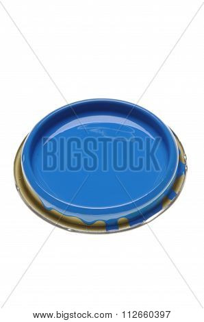 Can lid with blue paint isolated on white background