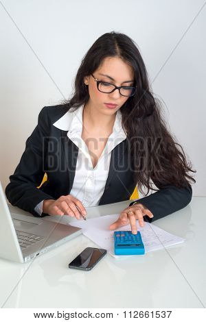 business woman using pocket calculator