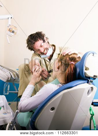 Crazy dentist treats teeth of the unfortunate patient. The patient is terrified.