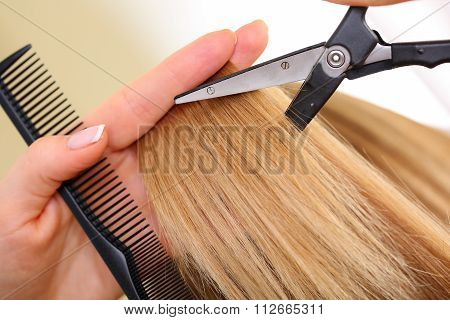 Female Hand Holding Comb And Hot Thermal Scissors