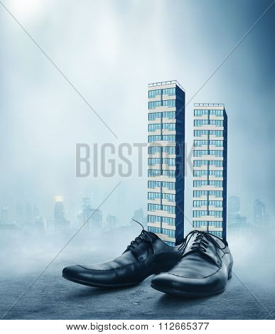 Office buildings in the male classic shoes against the cityscape