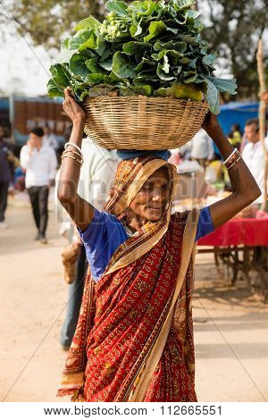 A Woman Carrying Produce At Local Food Market, Kanha.