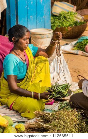 A Woman Selling Produce At A Local Food Market, Kanha.