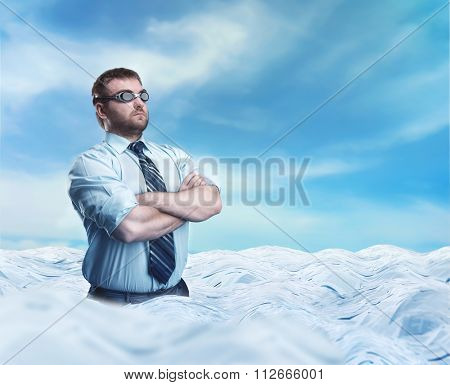 Businessman swimmer with crossed hands in the sea of papers