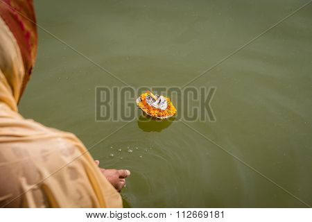 Hindu Woman Makes And Aarti Offering To Shiva On The Ghats Of The River Ganges, Varanasi.