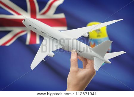 Airplane In Hand With Flag On Background - Saint Helena