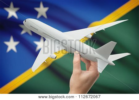 Airplane In Hand With Flag On Background - Solomon Islands