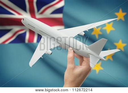 Airplane In Hand With Flag On Background - Tuvalu