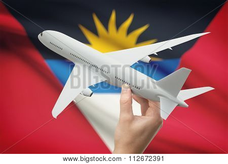 Airplane In Hand With Flag On Background - Antigua And Barbuda