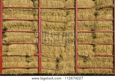 Hay Bales Piled Within A Cart