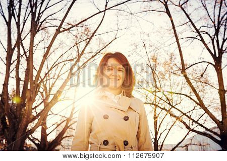 Young smiling business woman professional outdoors in sunset