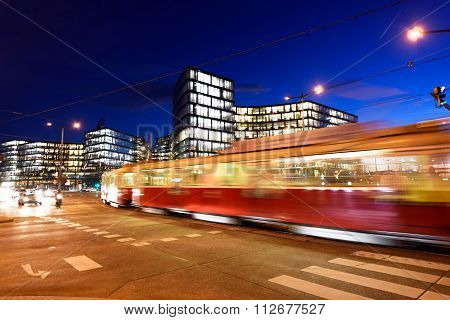 VIENNA, AUSTRIA - NOVEMBER 2015: Red train on Belvedere Palace street at dusk