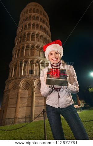 Woman Showing Christmas Gift Box Near Leaning Tower Of Pisa