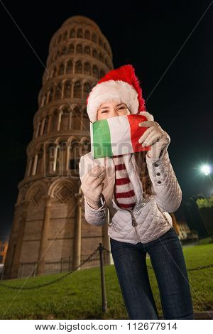 Woman In Santa Hat With Italian Flag Near Leaning Tower Of Pisa