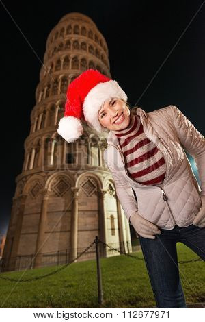 Merry Woman In Santa Hat Standing Near Leaning Tower Of Pisa