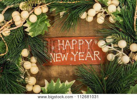 happy new year written on wooden background