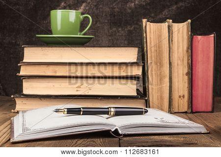 Green Mug On Books