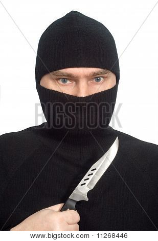 Man In Black Clothes With A Knife.