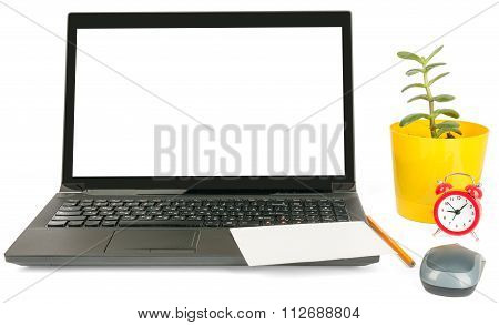 Laptop with blank card and alarm clock