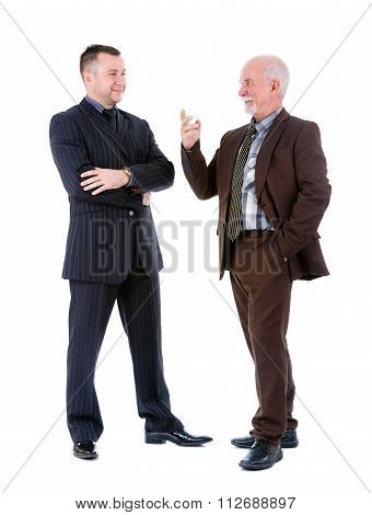 Young And Old Senior Two Businessman In Suits Discussing. Isolated On White Background.