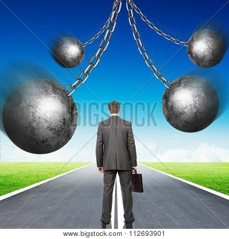 Businessman with set of iron balls