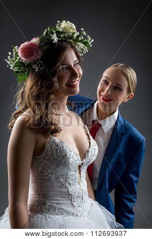 Lesbian wedding. Happy bride and groom posing